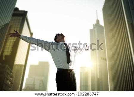 happy young businessman and big city - stock photo