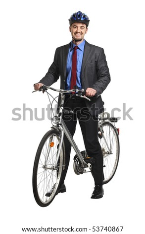 happy young businessman and his bicycle - stock photo