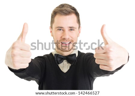 Happy young businessman in black showing thumbs up - stock photo