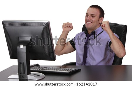 Happy young businessman in fornt of his computer, isolated against a white background. - stock photo