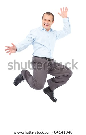 Happy young businessman jumping for joy, isolated on white background - stock photo