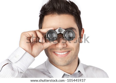 Happy young businessman looking through binocular isolated on white background. - stock photo