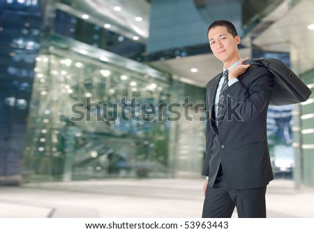 Happy young businessman of Asian outside of office. - stock photo
