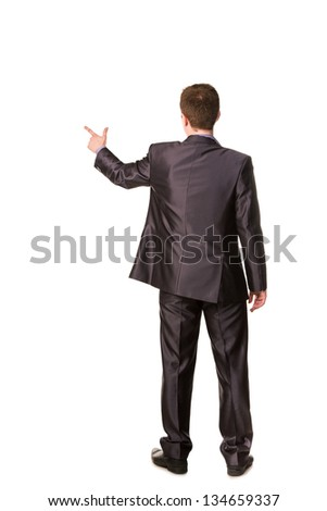 Happy young businessman's back pointing finger at emoty space for your text isolated on white - stock photo