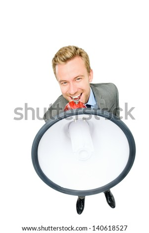 Happy young businessman shouting with megaphone on white background - stock photo