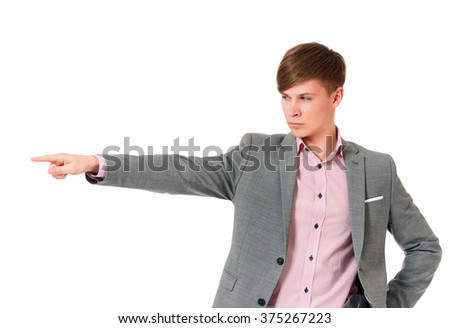 Happy young businessman showing empty copyspace on white background  - stock photo