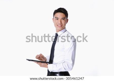 Happy Young businessman Using Digital Tablet Isolated   - stock photo