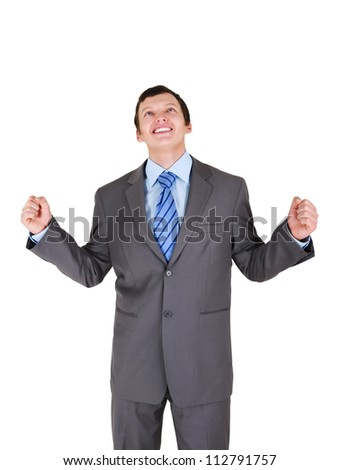 Happy young businessman with his hands up on white background - stock photo