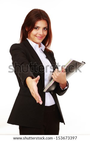 Happy young businesswoman holding documents ready to handshake - stock photo