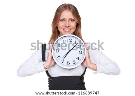 happy young businesswoman holding the clock and smiling. isolated on white background - stock photo
