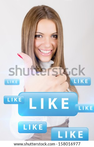 Happy young businesswoman showing thumb up like concept  - stock photo