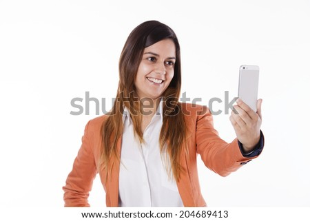 Happy young businesswoman taking herself a photo with a smart-phone - stock photo
