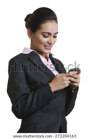 Happy young businesswoman using mobile phone isolated over white background - stock photo