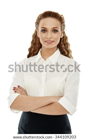 Happy young businesswoman with her arms folded on white background - stock photo