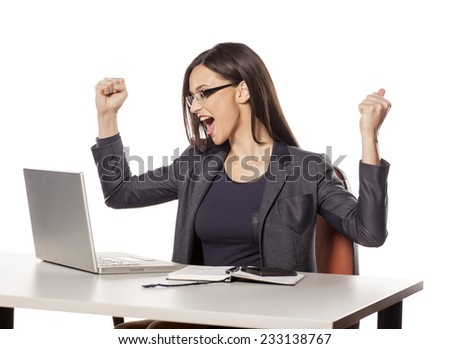 happy young businesswoman with the winning gesture - stock photo