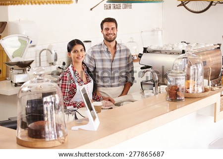 Happy young cafe staff - stock photo
