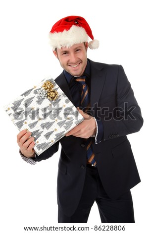 Happy young caucasian businessman with Santa hat showing Christmas gift . Studio shot. White background. - stock photo