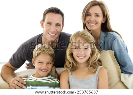 Happy young Caucasian family - portrait - stock photo