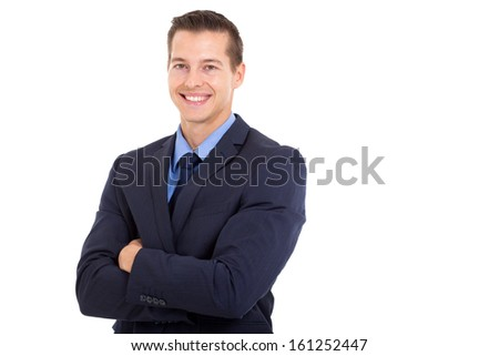 happy young corporate worker with arms folded on white background - stock photo