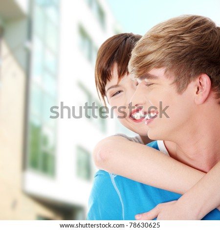 Happy young couple after buying new house - stock photo