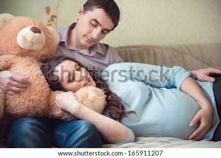 Happy young couple anticipating child birth - stock photo