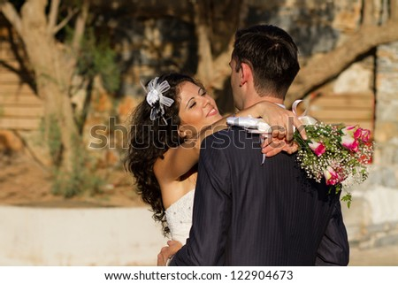Happy young couple dancing their wedding dance - stock photo