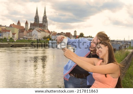 Happy young couple doing a selfie, Outdoor Shot - stock photo