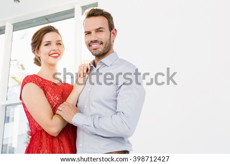 Happy young couple embracing each other - stock photo