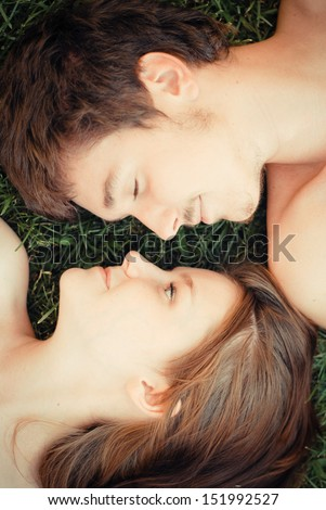 Happy young couple embracing in love - stock photo