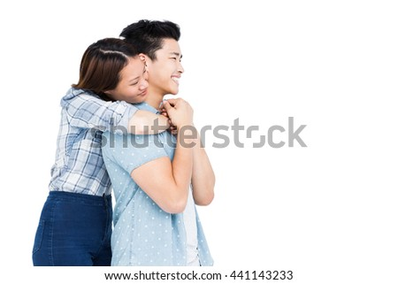 Happy young couple embracing on white background - stock photo