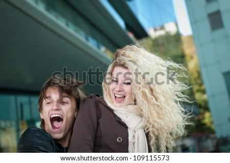 Happy young couple enjoying life - stock photo