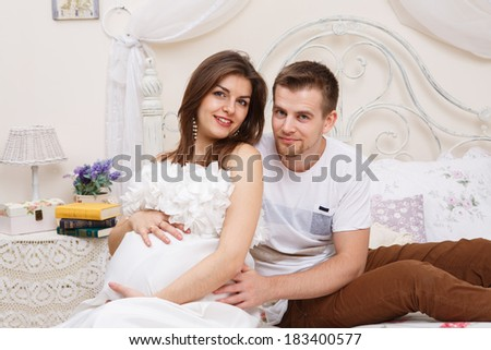 Happy, young couple expecting a new baby - stock photo