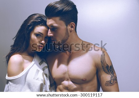 Happy young couple. Fashion colors. - stock photo