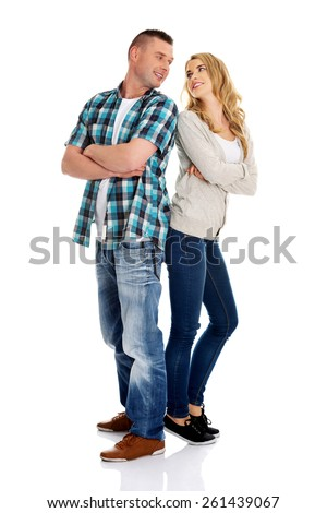 Happy young couple folded arms - stock photo