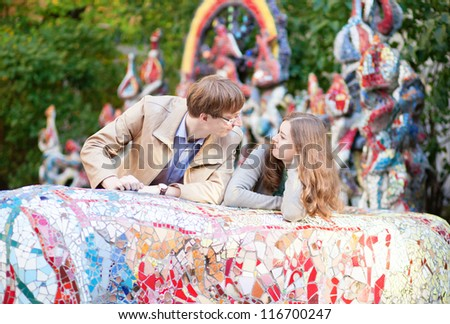 Happy young couple having a date outdoors - stock photo