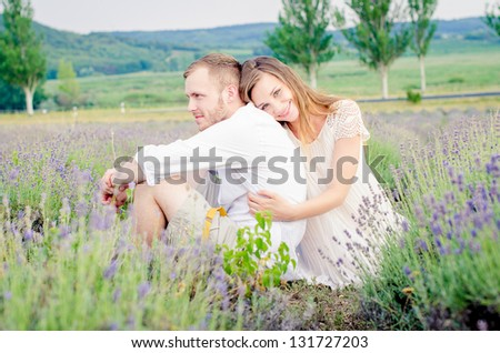 Happy young couple having fun - stock photo