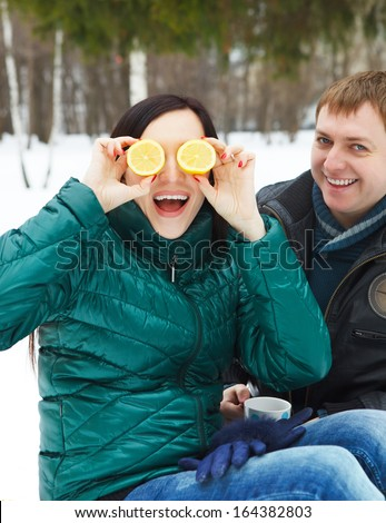 Happy young couple having fun in the winter park - stock photo
