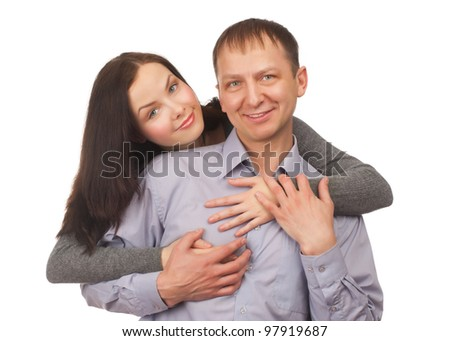 Happy young couple hugging, isolated on white background - stock photo