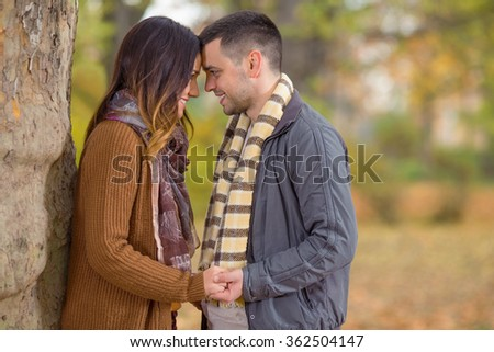 Happy young couple in a park - stock photo