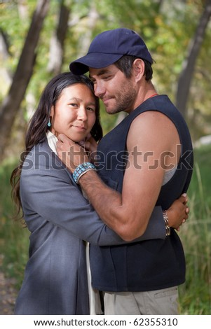 Happy young couple in fall forest - stock photo