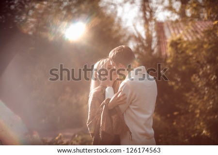 happy young couple in love outdoor in autumn - stock photo