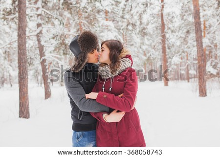 http://thumb101.shutterstock.com/display_pic_with_logo/2797723/368058743/stock-photo-happy-young-couple-in-winter-park-having-fun-family-outdoors-valentine-s-day-368058743.jpg