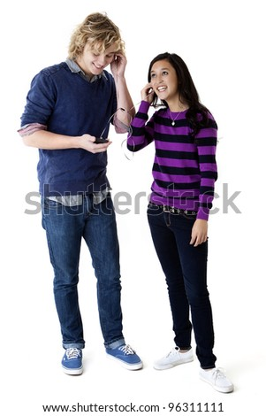 happy young couple listening to music - stock photo