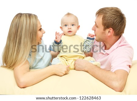happy young couple   lying down with the baby - stock photo