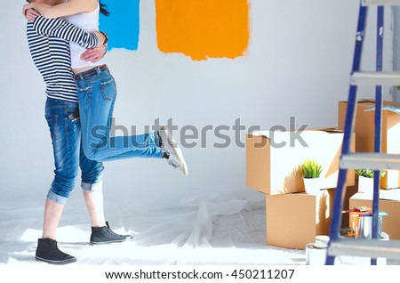 Happy young couple moving in new house - stock photo