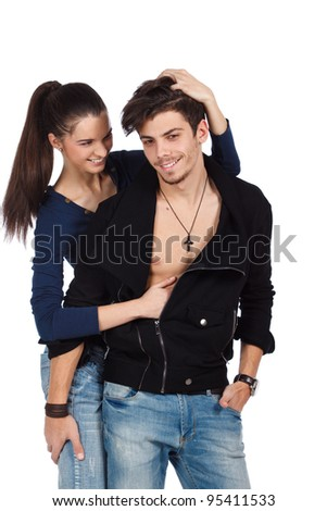 Happy young couple of handsome man and beautiful woman flirting and touching each other. Isolated on white background. High resolution studio image - stock photo