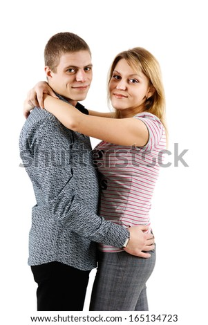 Happy young couple on a white background - stock photo