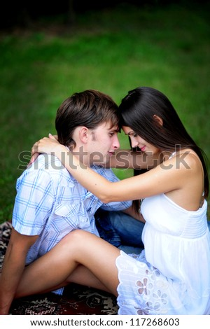 Happy young couple on picnic  in park - stock photo
