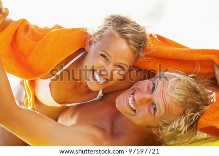 Happy young couple on the beach - stock photo