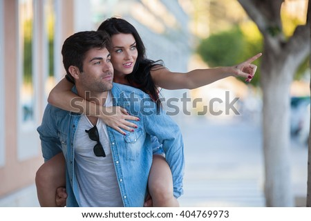 HAPPY YOUNG COUPLE ON VACATIONS - stock photo